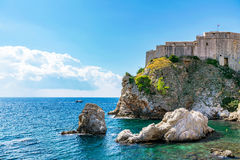 Lovrijenac fortress wall with blue sky. View of Lovrijenac fortress wall with blue sky and mediterranean ocean Royalty Free Stock Photos