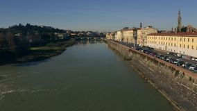 Low altitude aerial view of the Arno river in Florence oa sunny day. Tuscany, Italy. Low altitude aerial view of the Arno river in Florence oa sunny day stock video