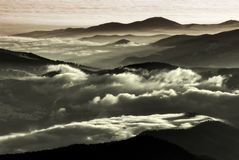 Low altitude clouds over the mountains Royalty Free Stock Image