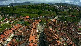 Low altitude flight over the Old City tiled houses of Bern. Switzerland. Low altitude flight over the Old City tiled houses of Bern stock photos