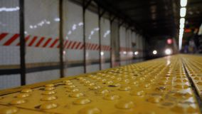Low Angle Approaching Subway Train. A low angle stationary shot of an approaching Manhattan subway car stock footage