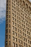 Low Angle Architectural Exterior View of Upper Floors of Historic Flatiron Building in Manhattan, New York City stock photography