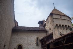 Low angle of beautiful tower in chateau de chillon, castle in Montreux Switzerland, on cloudy sky background. With copy space stock photos