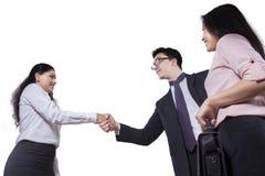 Low angle businesspeople handshaking Stock Photos