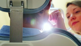 Low angle close up of female dentist turning on lamp and examining patient stock video