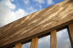 Wooden Banister & Blue Cloudy Sky Stock Photos