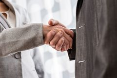 Low angle closeup view of a business handshake royalty free stock photos