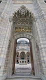Low angle day shot of one of the entrances leading to the court of Suleymaniye Mosque, Istanbul, Turkey. Istanbul, Turkey - April 17, 2017: Low angle day shot of Stock Image