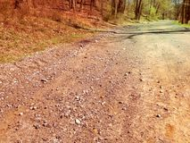 Low angle of a dirty road leading to nowhere Royalty Free Stock Photography