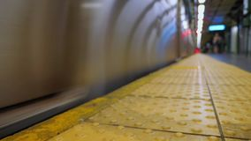 Low Angle Dolly Shot of Approaching Subway Train. A low angle slow dolly shot of an approaching New York City subway train stock video