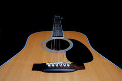 Low angle down body of acoustic guitar Royalty Free Stock Image