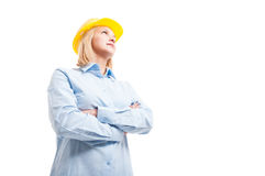 Low angle female engineer posing with arms crossed. Low angle hero shot of female engineer posing with arms crossed being serious isolated on white background stock image