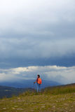 Female with hiking poles in Carpathian mountains Royalty Free Stock Image