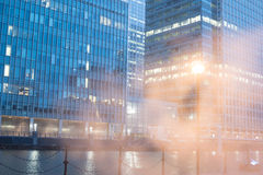Low angle of glass office building exteriors Stock Photo