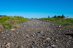Low Angle of Gravel Covered Trail Stock Photo