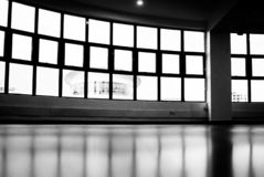 Low-angle and Grayscale Photography of Glass Pane Windows Overlooking Round Building royalty free stock images