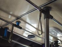 Low angle hand Hanging strap on buslow angle selective on hand Hanging strap on bus royalty free stock photography