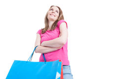 Low angle of happy shopaholic with shopping paper bags Royalty Free Stock Photo