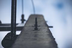 A low angle image of electricity post with blur blue sky Stock Photography