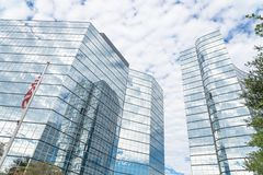 Low angle look up view of high-rise glass skyscraper and America stock photography