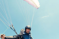 Low angle of male paraglider holding ropes Stock Images