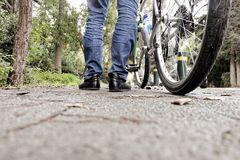 Low angle of a man with his bicycle Royalty Free Stock Photos
