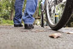 Low angle of a man with his bicycle Stock Photography
