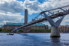 Low angle of Millenium Bridge, with view of the Tate Modern and blue sky Stock Photos