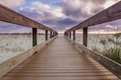Low Angle of Morning Clouds Over Boardwalk Royalty Free Stock Image