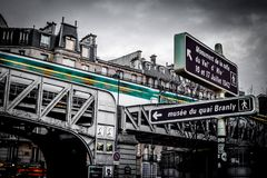 Low-angle of old railway bridge downtown in Paris royalty free stock photo