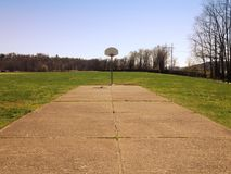 Low angle of an outdoor basketball court Stock Image