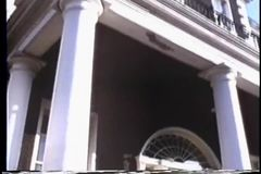 Low angle pan of  house to American Insurance Sign stock video