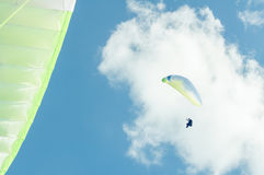Low angle of paraglider in the blue sky Royalty Free Stock Photos