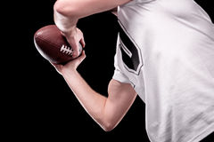 Low angle partial view of man in white t-shirt holding rugby ball Stock Photo
