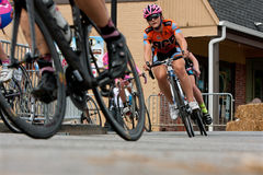 Low-Angle Perspective Of Female Cyclists Racing Into Turn Stock Photos