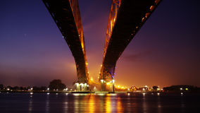 Low Angle Photo of Brown Bridge at Night Time Royalty Free Stock Photography