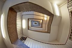 Low Angle Photo of Brown and White Spiral Stairs Building Stock Photos