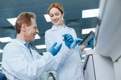 Low angle photo of delighted medical workers during discussion Stock Photo