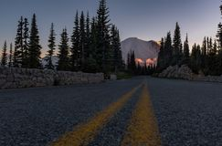 A low angle photo of the road leading up to Mount Rainier at sunset, Washington, USA stock photography