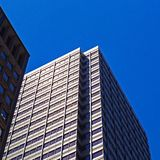 Low-angle Photo of White Concrete Building Under Blue Sky royalty free stock photos