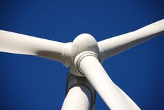 Low Angle Photo of White Wind Turbine Under Deep Blue Sky Royalty Free Stock Photography