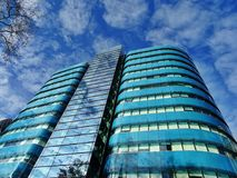 Low Angle Photography of Blue Tinted Glass Buildings Stock Image