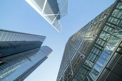 Low Angle Photography of Buildings Under Blue and White Sky Stock Photo