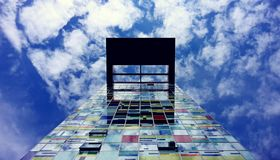 Low Angle Photography of Glass Building Under White Cloud and Blue Sky during Daytime Royalty Free Stock Photography