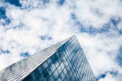 Low Angle Photography of Glass Building Under White Clouds and Blue Sky during Daytime Stock Images