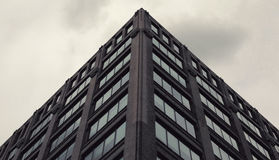 Low Angle Photography of Gray Concrete Building Under Gray Clouds Royalty Free Stock Photo