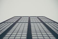 Low Angle Photography of High Rise Building Under Grey Sky Stock Photography