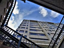 Low-angle Photography of High Rise Building Under Stratus Clouds Stock Photos