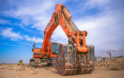 Low Angle Photography of Orange Excavator Under White Clouds stock photos