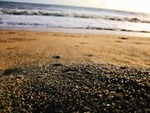 Low-angle Photography of Sand Near Body of Water stock images